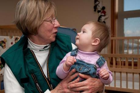for Travel - 12childcare - Moe Morrell and her colleagues care for babies that are 2 to 11 months old in the infant room at Deer Valley Children�s Center in Park City, Utah. Morrell is pictured here with Grace Wright of Bellingham, Wash., who was having her first daycare experience. (Kari Bodnarchuk for the Boston Globe)